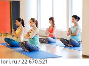 Купить «happy pregnant women exercising yoga in gym», фото № 22670521, снято 5 марта 2016 г. (c) Syda Productions / Фотобанк Лори