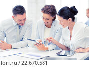 Купить «business team working with tablet pcs in office», фото № 22670581, снято 9 июня 2013 г. (c) Syda Productions / Фотобанк Лори