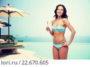 happy young woman in swimsuit drinking champagne. Стоковое фото, фотограф Syda Productions / Фотобанк Лори