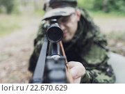 Купить «close up of soldier or hunter with gun in forest», фото № 22670629, снято 14 августа 2014 г. (c) Syda Productions / Фотобанк Лори