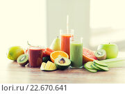 Купить «close up of fresh juice glass and fruits on table», фото № 22670641, снято 17 марта 2015 г. (c) Syda Productions / Фотобанк Лори