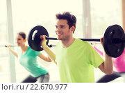 Купить «group of people exercising with barbell in gym», фото № 22670977, снято 5 апреля 2015 г. (c) Syda Productions / Фотобанк Лори