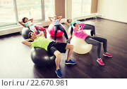 Купить «happy people flexing abdominal muscles on fitball», фото № 22670981, снято 5 апреля 2015 г. (c) Syda Productions / Фотобанк Лори
