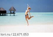 Купить «happy young woman jumping over exotic beach», фото № 22671053, снято 4 августа 2012 г. (c) Syda Productions / Фотобанк Лори