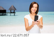 Купить «happy woman taking selfie by smartphone over beach», фото № 22671057, снято 25 июля 2013 г. (c) Syda Productions / Фотобанк Лори