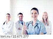 Купить «doctor with group of medics showing thumbs up», фото № 22671277, снято 18 мая 2013 г. (c) Syda Productions / Фотобанк Лори