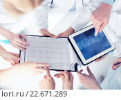 Купить «group of doctors looking at x-ray on tablet pc», фото № 22671289, снято 18 мая 2013 г. (c) Syda Productions / Фотобанк Лори
