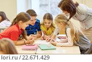 Купить «group of school kids writing test in classroom», фото № 22671429, снято 11 июля 2020 г. (c) Syda Productions / Фотобанк Лори