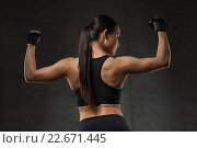 Купить «young woman flexing muscles in gym», фото № 22671445, снято 12 декабря 2015 г. (c) Syda Productions / Фотобанк Лори