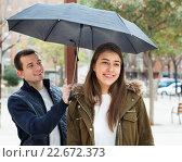 Купить «Young couple having a city walk and smiling», фото № 22672373, снято 15 декабря 2017 г. (c) Яков Филимонов / Фотобанк Лори
