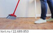 Купить «woman with broom cleaning floor at home», видеоролик № 22689853, снято 17 апреля 2016 г. (c) Syda Productions / Фотобанк Лори