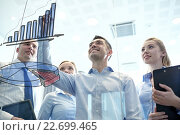 Купить «smiling business people with marker and stickers», фото № 22699465, снято 25 октября 2014 г. (c) Syda Productions / Фотобанк Лори