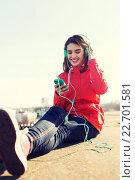 Купить «happy young woman with smartphone and headphones», фото № 22701581, снято 19 марта 2015 г. (c) Syda Productions / Фотобанк Лори