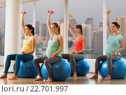 Купить «happy pregnant women exercising on fitball in gym», фото № 22701997, снято 5 марта 2016 г. (c) Syda Productions / Фотобанк Лори
