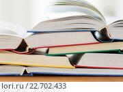 Купить «close up of books on wooden table», фото № 22702433, снято 17 марта 2016 г. (c) Syda Productions / Фотобанк Лори