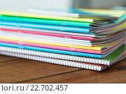 Купить «close up of notebooks on wooden table», фото № 22702457, снято 17 марта 2016 г. (c) Syda Productions / Фотобанк Лори
