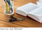 close up of pens, book and scissors on table. Стоковое фото, фотограф Syda Productions / Фотобанк Лори