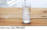Купить «water pouring into glass on wooden table», видеоролик № 22709681, снято 2 апреля 2016 г. (c) Syda Productions / Фотобанк Лори