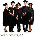 Купить «Multi ethnic group of graduated young students isolated on white», фото № 22710657, снято 24 апреля 2014 г. (c) Andrejs Pidjass / Фотобанк Лори