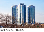 New tall modern apartment buildings against blue sky background, фото № 22716865, снято 29 марта 2016 г. (c) FotograFF / Фотобанк Лори