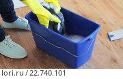 Купить «woman washing and squeezing rag in bucket at home», видеоролик № 22740101, снято 17 апреля 2016 г. (c) Syda Productions / Фотобанк Лори