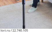 Купить «woman with vacuum cleaner cleaning carpet at home», видеоролик № 22740105, снято 17 апреля 2016 г. (c) Syda Productions / Фотобанк Лори