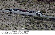 Купить «Vehicle driving on TF-21 driveway. Road passing through the Teno massif and has a turn to Teide Cable car. Tenerife, Canary islands, Spain», видеоролик № 22766821, снято 18 февраля 2016 г. (c) Кекяляйнен Андрей / Фотобанк Лори