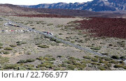 Купить «Valley with road turn to the parking area and lower station of Teleferico cable car. Teide volcano, Tenerife, Canary islands, Spain», видеоролик № 22766977, снято 18 февраля 2016 г. (c) Кекяляйнен Андрей / Фотобанк Лори