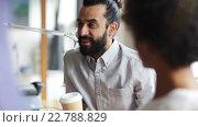 Купить «happy creative team drinking coffee in office», видеоролик № 22788829, снято 3 апреля 2015 г. (c) Syda Productions / Фотобанк Лори