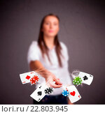 Купить «Young woman playing with poker cards and chips», фото № 22803945, снято 19 февраля 2020 г. (c) easy Fotostock / Фотобанк Лори