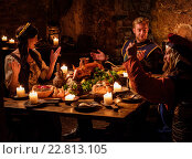 Купить «Medieval people eat and drink in ancient castle kitchen interior.», фото № 22813105, снято 22 апреля 2016 г. (c) Andrejs Pidjass / Фотобанк Лори