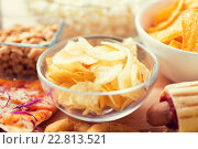 Купить «close up of crunchy potato crisps in glass bowl», фото № 22813521, снято 21 мая 2015 г. (c) Syda Productions / Фотобанк Лори