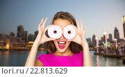 Купить «happy woman or teen girl looking through donuts», фото № 22813629, снято 31 октября 2015 г. (c) Syda Productions / Фотобанк Лори