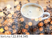 Купить «close up coffee cup and grains on wooden table», фото № 22814345, снято 7 апреля 2016 г. (c) Syda Productions / Фотобанк Лори