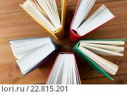 Купить «close up of books on wooden table», фото № 22815201, снято 17 марта 2016 г. (c) Syda Productions / Фотобанк Лори