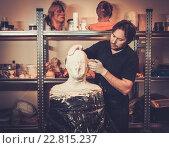 Купить «Men during lifecasting process in a prosthetic special fx workshop», фото № 22815237, снято 19 марта 2015 г. (c) Andrejs Pidjass / Фотобанк Лори