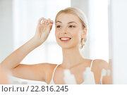Купить «woman with tweezers tweezing eyebrow at bathroom», фото № 22816245, снято 13 февраля 2016 г. (c) Syda Productions / Фотобанк Лори