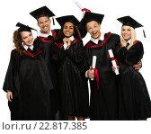 Купить «Multi ethnic group of graduated young students isolated on white», фото № 22817385, снято 24 апреля 2014 г. (c) Andrejs Pidjass / Фотобанк Лори