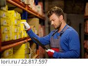 Купить «Worker on a automotive spare parts warehouse», фото № 22817597, снято 2 октября 2015 г. (c) Andrejs Pidjass / Фотобанк Лори