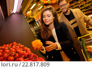 Купить «Couple choosing vegetables in a grocery store», фото № 22817809, снято 9 октября 2015 г. (c) Andrejs Pidjass / Фотобанк Лори