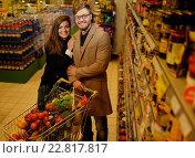 Купить «Young couple in a grocery store», фото № 22817817, снято 9 октября 2015 г. (c) Andrejs Pidjass / Фотобанк Лори