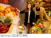 Купить «Couple choosing vegetables in a grocery store», фото № 22817905, снято 9 октября 2015 г. (c) Andrejs Pidjass / Фотобанк Лори