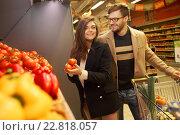 Купить «Couple choosing vegetables in a grocery store», фото № 22818057, снято 9 октября 2015 г. (c) Andrejs Pidjass / Фотобанк Лори