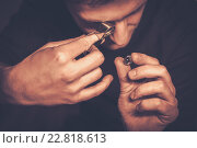 Купить «Portrait of a jeweler during the evaluation of jewels.», фото № 22818613, снято 26 декабря 2015 г. (c) Andrejs Pidjass / Фотобанк Лори