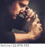 Купить «Portrait of a jeweler during the evaluation of jewels.», фото № 22819153, снято 26 декабря 2015 г. (c) Andrejs Pidjass / Фотобанк Лори
