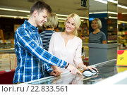 Купить «Happy family standing near display with frozen food», фото № 22833561, снято 15 ноября 2018 г. (c) Яков Филимонов / Фотобанк Лори