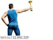Rear view of athletic man holding the Olympic torch. Стоковое фото, агентство Wavebreak Media / Фотобанк Лори