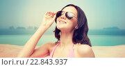 Купить «happy woman in sunglasses and swimsuit», фото № 22843937, снято 14 апреля 2015 г. (c) Syda Productions / Фотобанк Лори