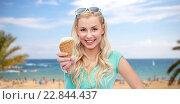 Купить «happy young woman in sunglasses eating ice cream», фото № 22844437, снято 13 февраля 2016 г. (c) Syda Productions / Фотобанк Лори
