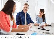 Купить «happy creative team or students working at office», фото № 22844565, снято 27 февраля 2016 г. (c) Syda Productions / Фотобанк Лори